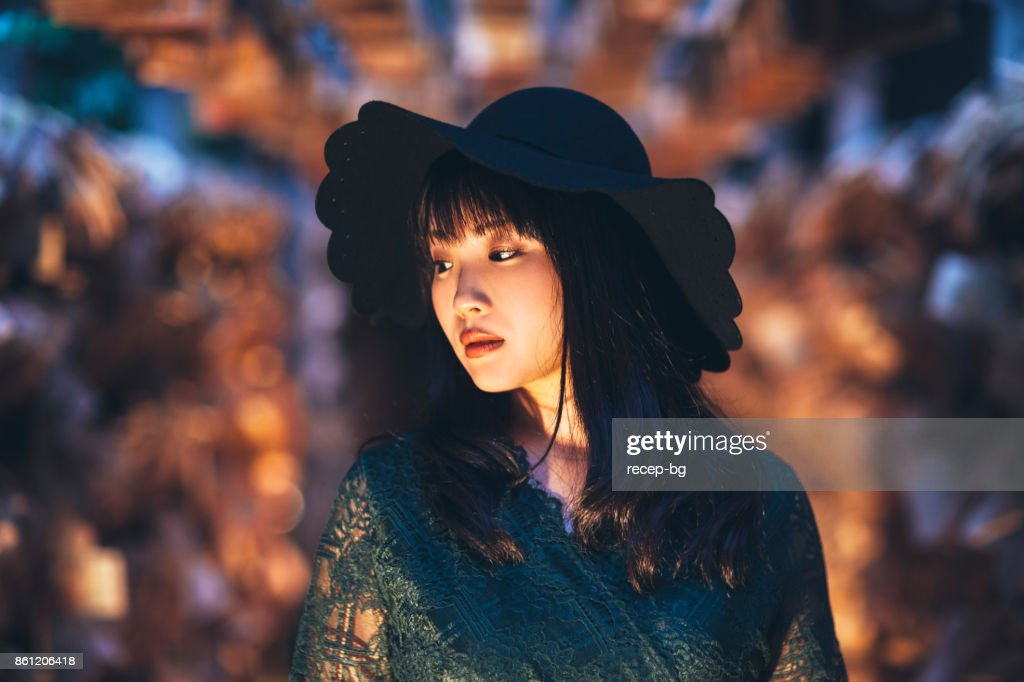 Young Woman With Hat At Night : Stock Photo