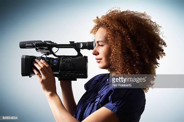 young woman with hd broadcast camcorder - cinematographer stock pictures, royalty-free photos & images