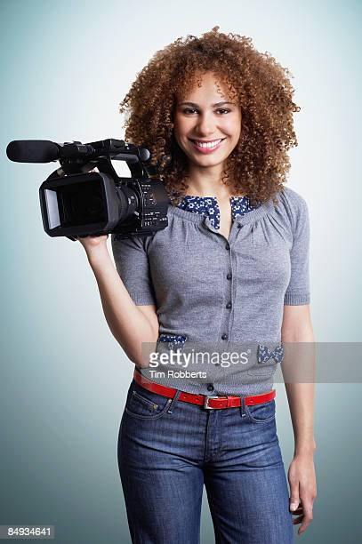 Young woman with HD broadcast camcorder