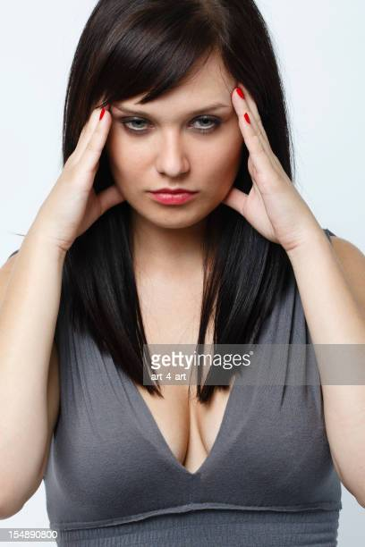 Young woman with headache pain