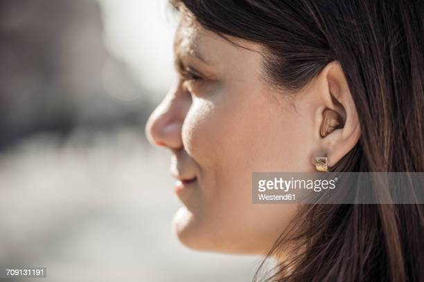 Young woman with hearing aid, close-up