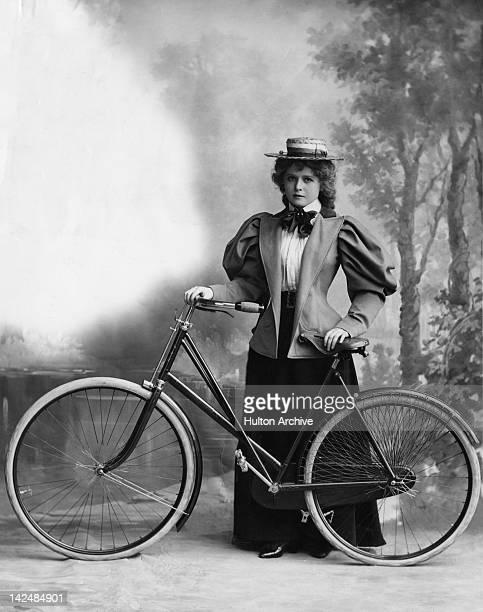 A young woman with her bicycle circa 1895