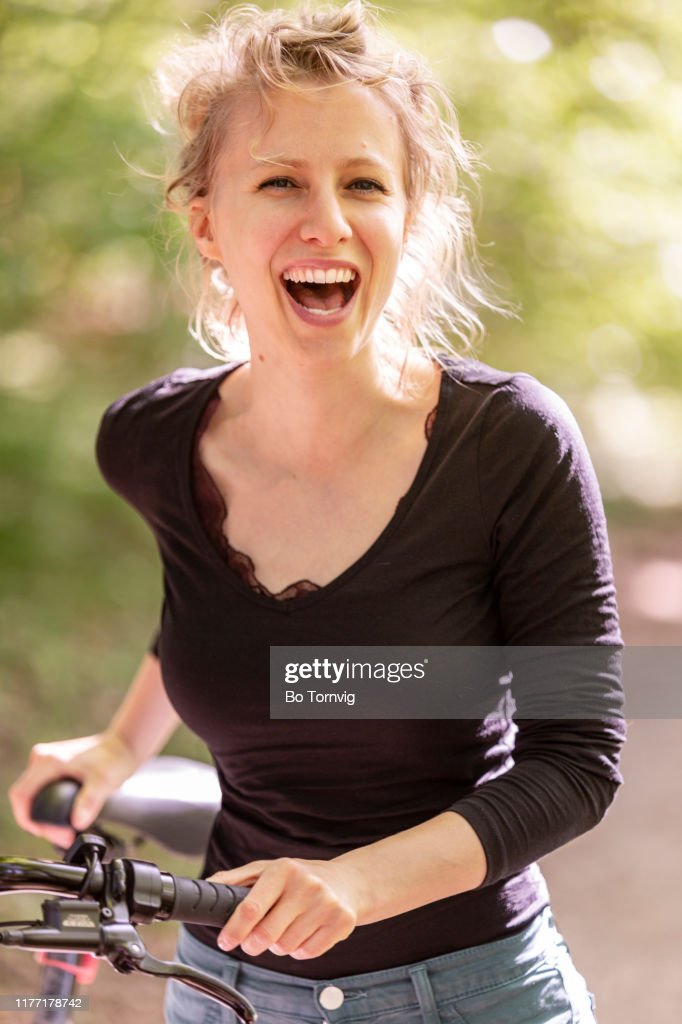 young woman with her bicycle : Stock Photo