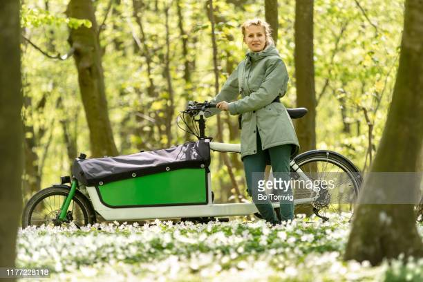 young woman with her cargo bike - bo tornvig stock pictures, royalty-free photos & images