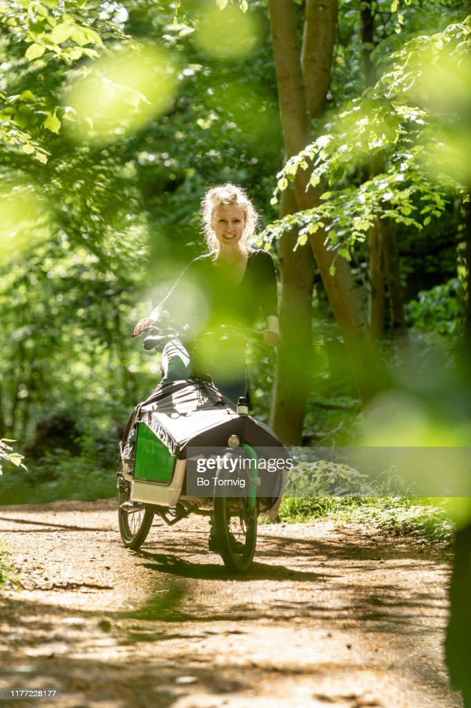 young woman with her cargo bike : Stock Photo