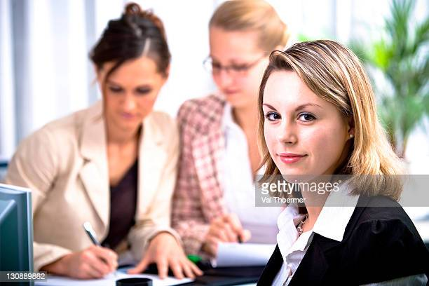 Young woman with her colleagues in an office