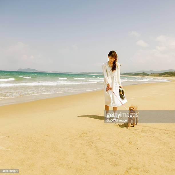 Young Woman With Her Dog At Beach