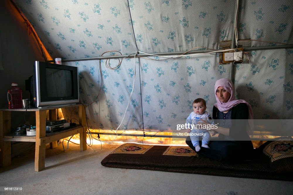 Young mother with toddler in a tent in the refugee camp Kabarto 2 in the autonomous Kurdistan Region of Iraq : News Photo