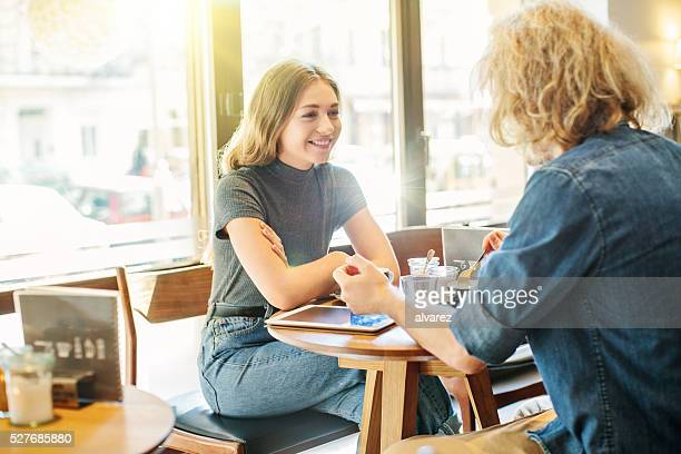Young woman with her friend at a cafe