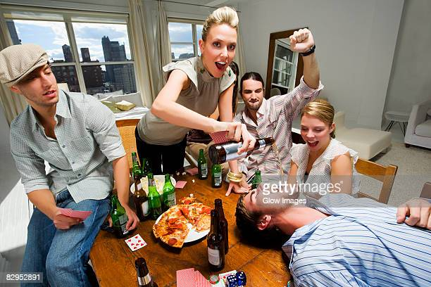Young woman with her friends enjoying a party