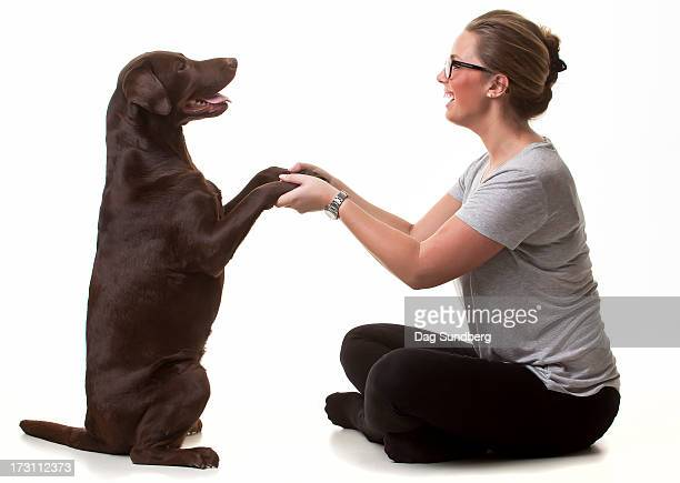 Young woman with her labrador retriever