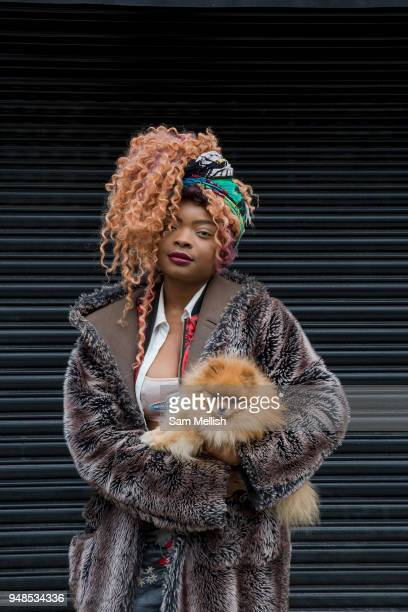 A young woman with her pet Pomeranian dog in Brixton on the 11th April 2018 in South London United Kingdom