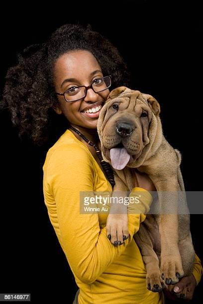 A young woman with her Shar-Pei, studio shot