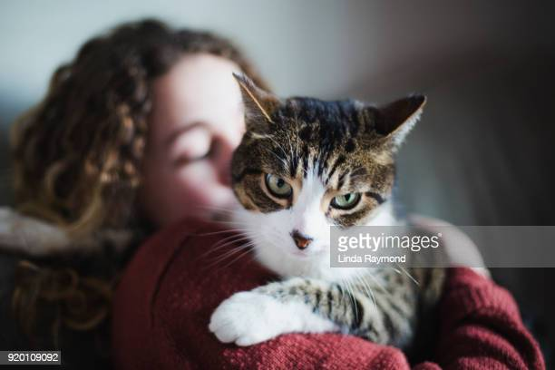 Young woman with her tabby cat