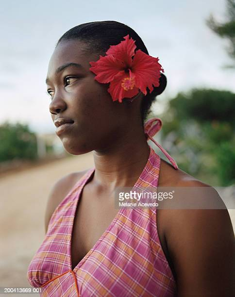 Young woman with hibiscus in hair, Anguilla