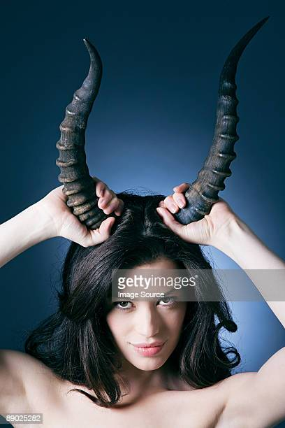 young woman with horns - devil stock pictures, royalty-free photos & images