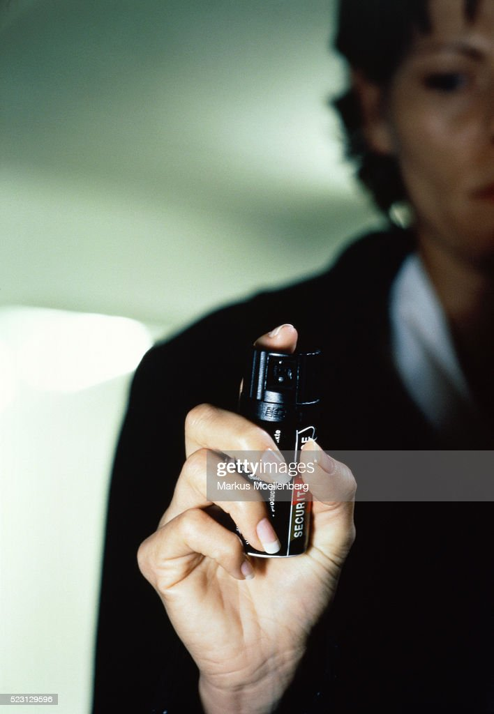 Young woman with irritation gas. : Stock Photo