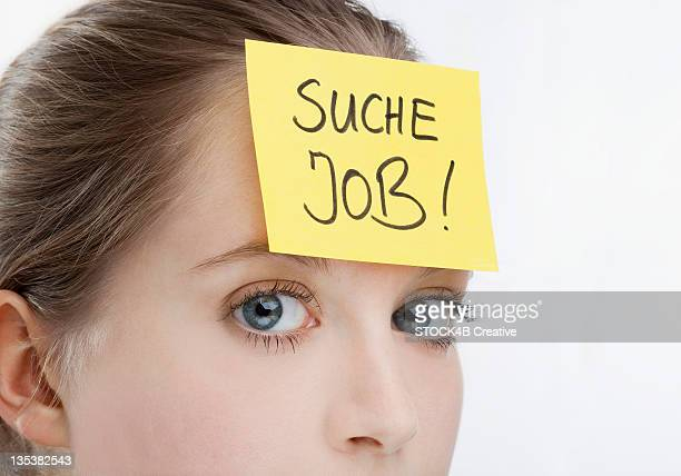 Young woman with job seeking paper on her forehead