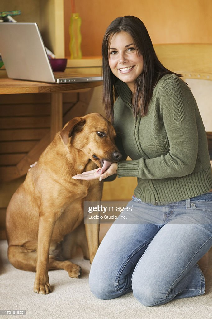 Young woman with labrador dog : Stock Photo
