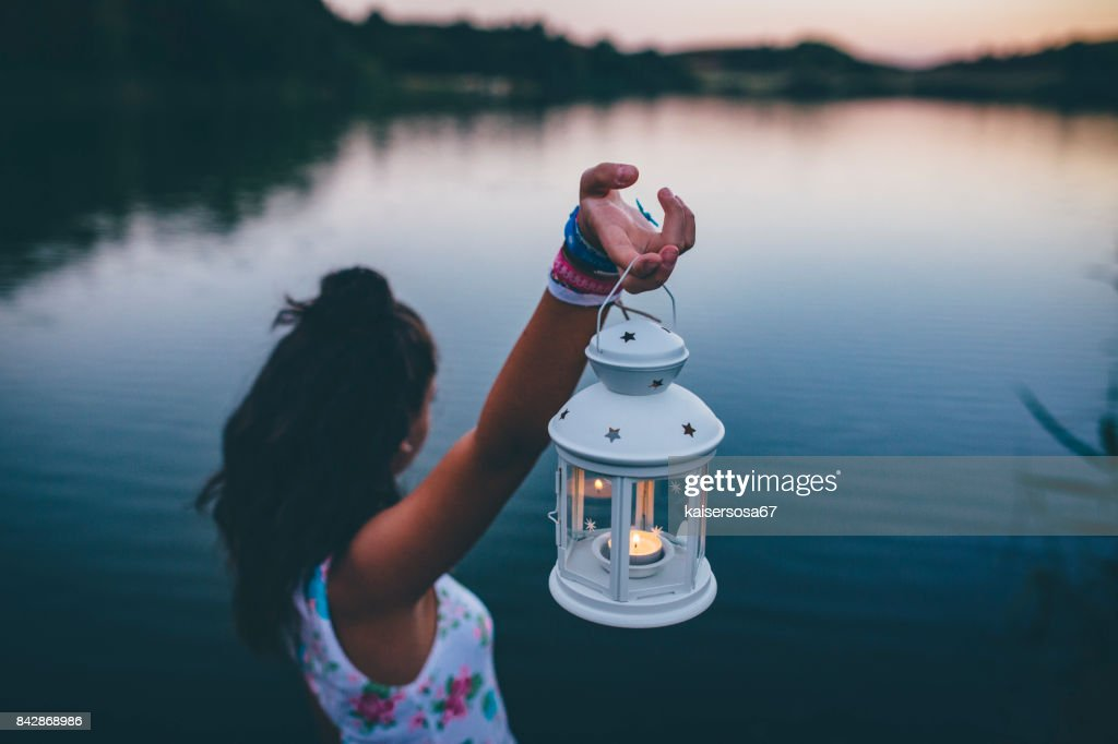 young woman with lantern exploring in nature : Stock Photo