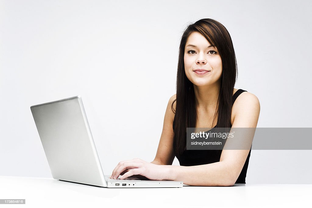 Young woman with laptop : Stock Photo