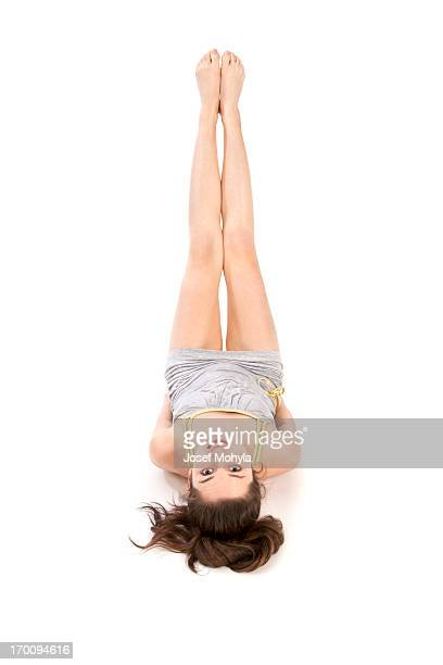 Young woman with legs in the air