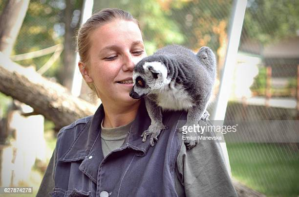 Young woman with Lemur on her shoulder
