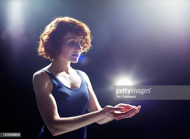 young woman with light. - paranormal stock pictures, royalty-free photos & images