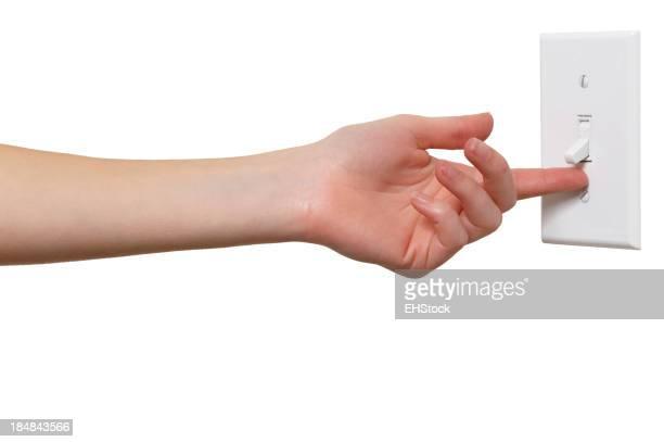 Junge Frau mit Licht-Schalter, isoliert auf weißem Hintergrund