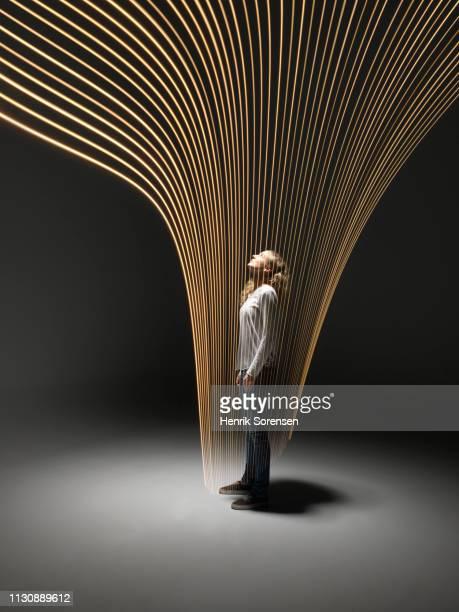 young woman with light trace - vorhersagen stock-fotos und bilder