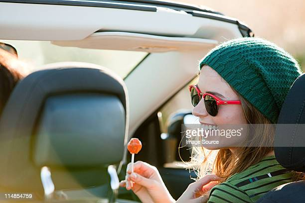 young woman with lollipop - lollipop stock pictures, royalty-free photos & images