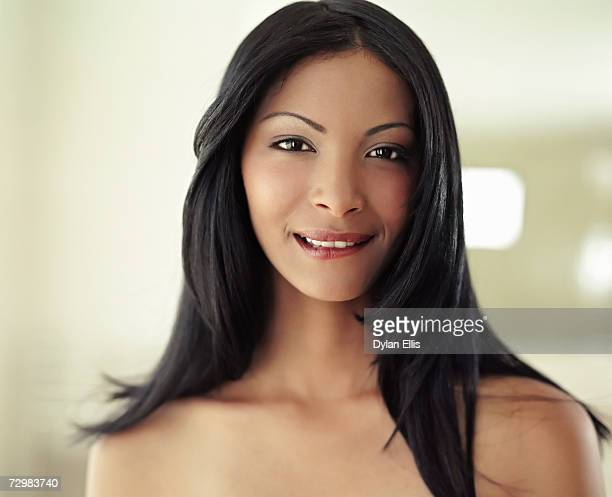 young woman with long black hair, biting lip, portrait - biting lip stock pictures, royalty-free photos & images