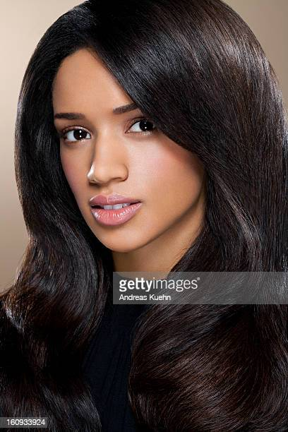 young woman with long black hair, portrait. - thick black woman stock photos and pictures