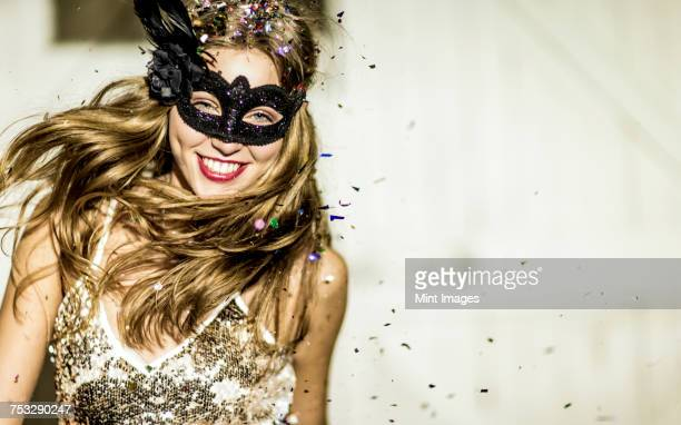 a young woman with long blonde hair at a glitter party, with falling confetti.  - cocktail dress stock pictures, royalty-free photos & images