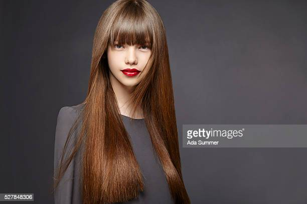young woman with long brown hair - straight hair stock pictures, royalty-free photos & images