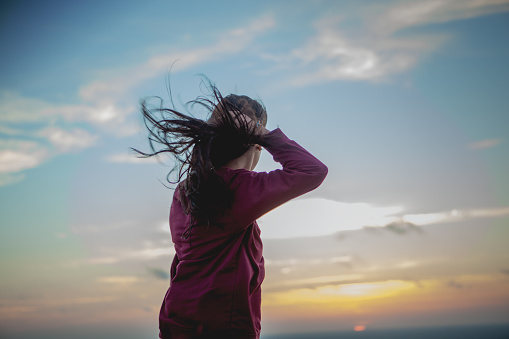 Young Woman With Long Hair Blowing In The Wind - gettyimageskorea