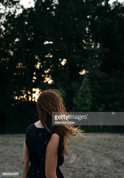Young woman with long hair enjoying sunset