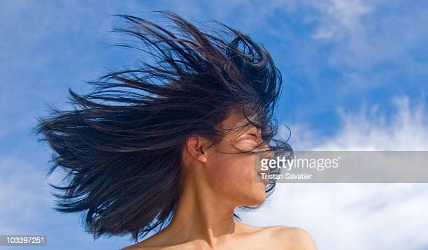 Young  woman with long hair in the wind