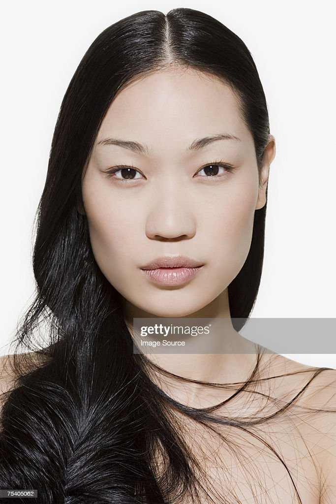 Young woman with long hair : Stock Photo