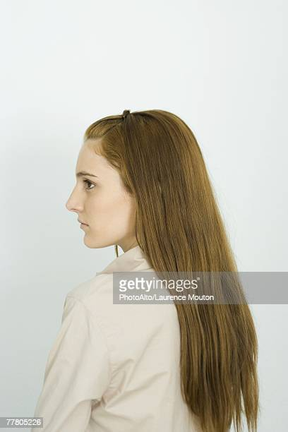 Young woman with long hair, profile, portrait