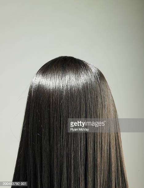 young woman with long hair, rear view - black hair stock pictures, royalty-free photos & images
