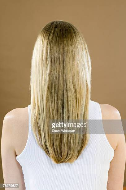 young woman with long hair, rear view - cheveux blonds photos et images de collection