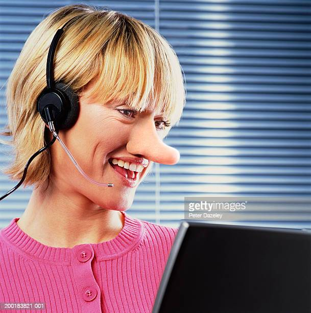 young woman with long nose wearing headset, smiling - big nose stock photos and pictures