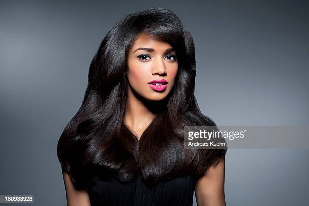 young woman with long, shiny, black hair,portrait. - zwart haar stockfoto's en -beelden