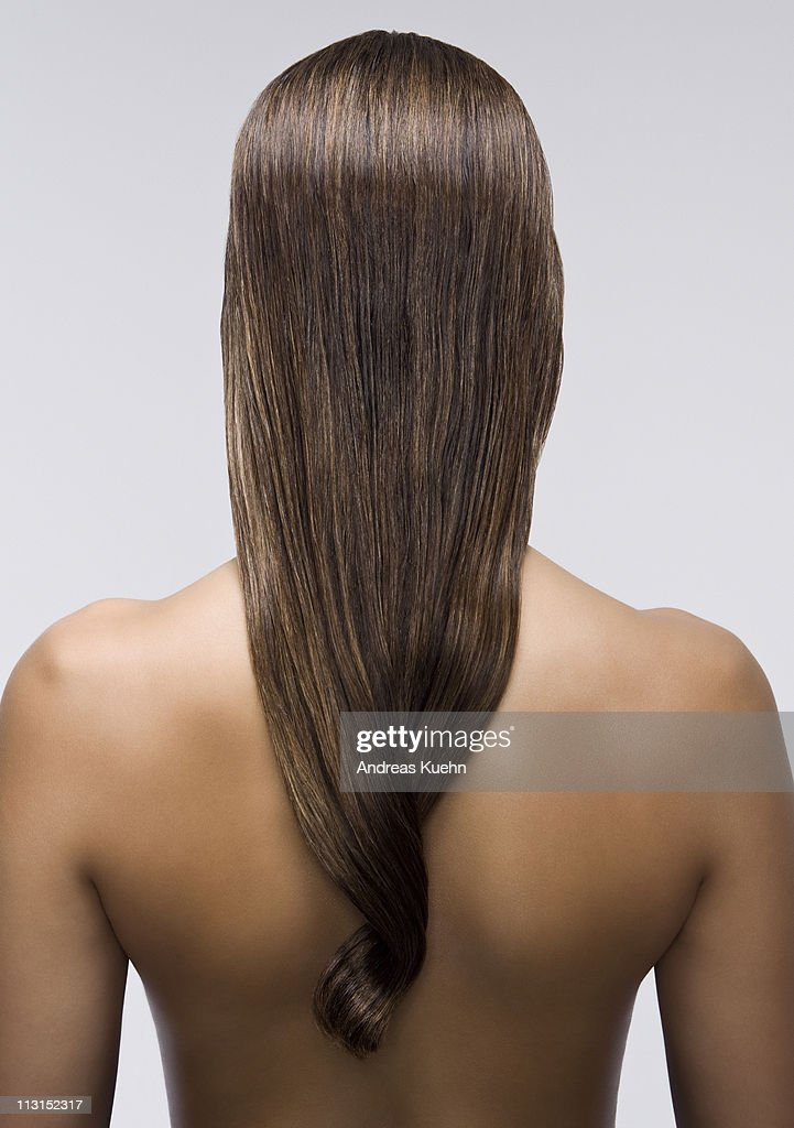 young woman with long shiny hair back view ストックフォト getty images
