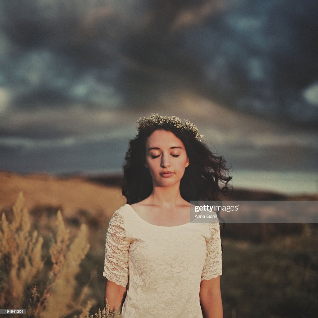Young woman with long wavy dark hair flower crown eyes closed young woman with long wavy dark hair flower crown eyes closed outdoors against izmirmasajfo Gallery