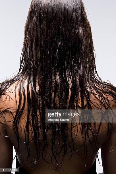 Young woman with long wet hair, back view.