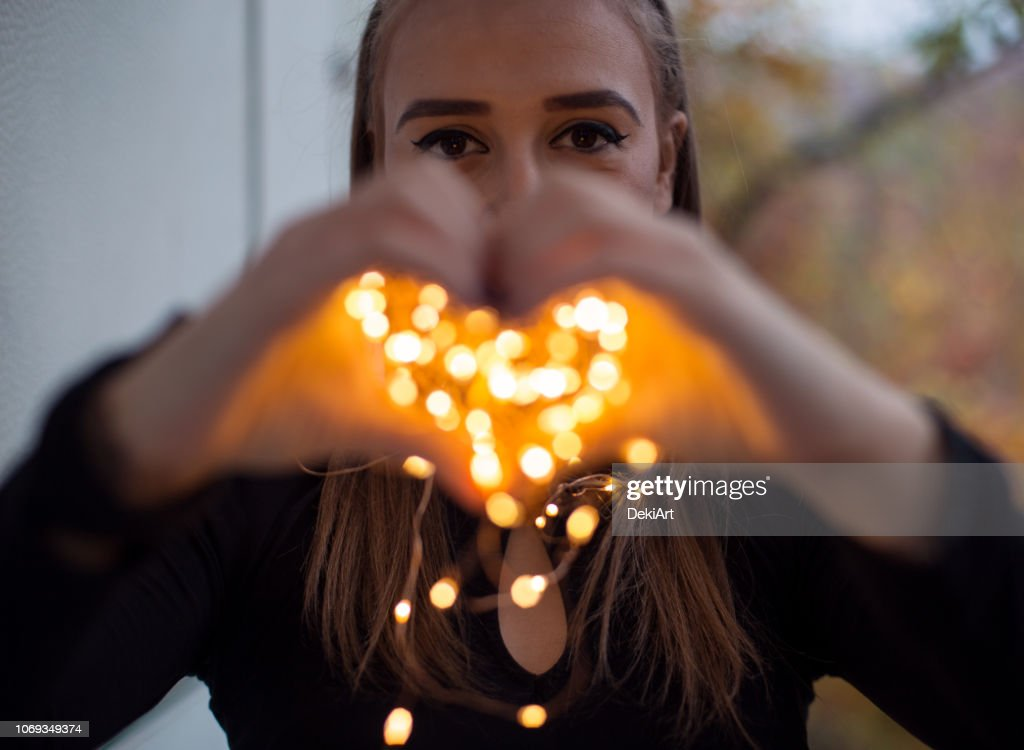 Young woman with magic lights : Stock Photo