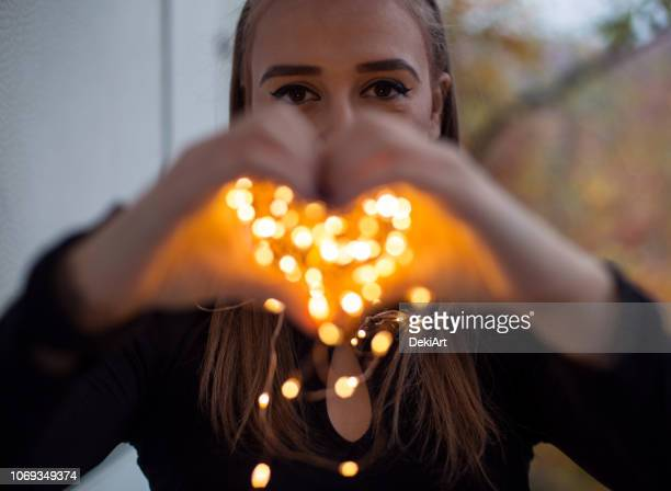 Young woman with magic lights