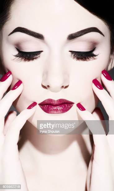 young woman with makeup, flashy makeup, beauty, portrait with hands - beautiful dominant women stock pictures, royalty-free photos & images